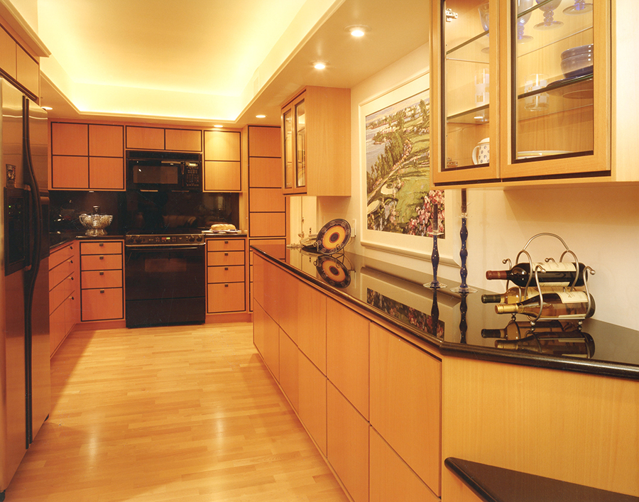 Bleached beech cabinets with ebony trim show off a complete renovation in a waterfront condo.