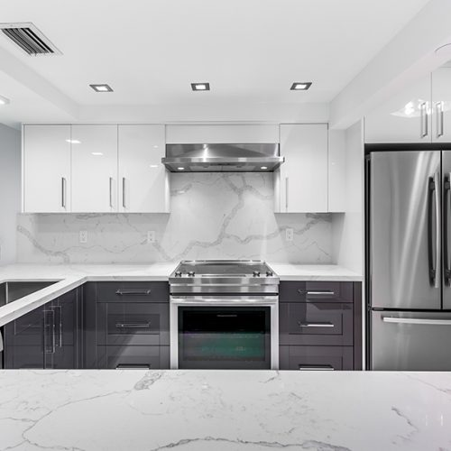 Slick and clean Kitchen design with Calacatta quartz counter top and backsplash.