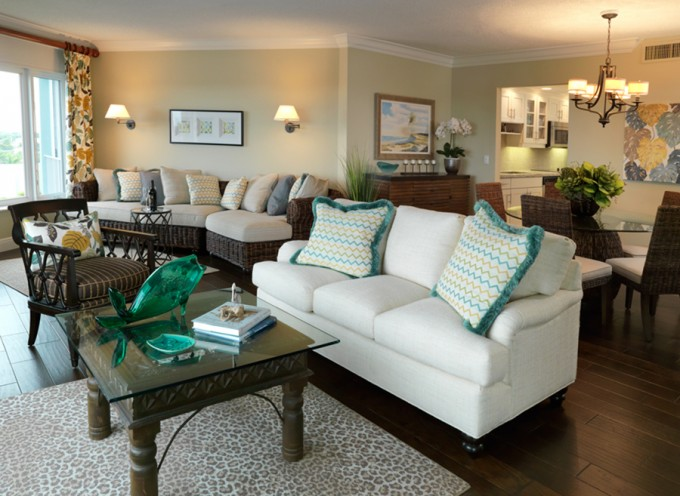 Delray Waterfront condo remodel in an Island theme with dark wood floors, rattan and teal fabric
