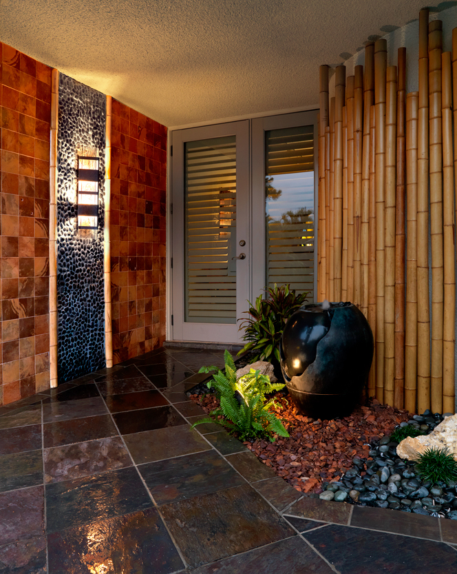 Dramatic Zen Entry with slate, bamboo, black rock, copper wall tile and ebony glazed fountain