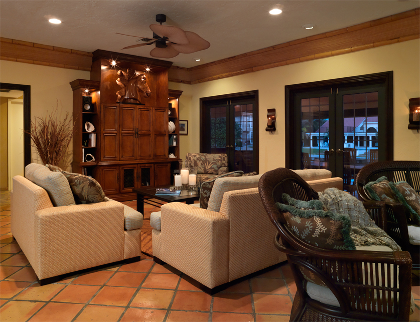Ocean Ridge: A cozy Living Room with custom wall unit and bamboo crown molding
