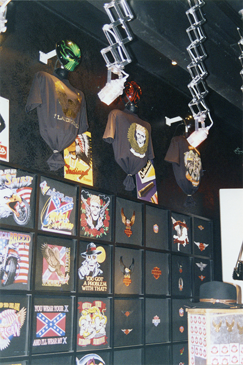 High tech lighting illuminate a wall of tee shirts in a store just for bikers