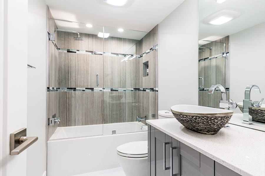 A Border Tile Of Grey White And Silver On The Shower Wall